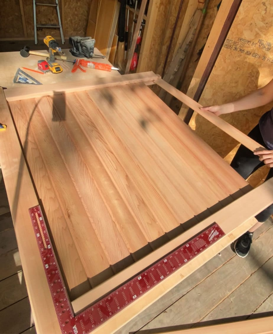 sliding tongue & groove boards into channel