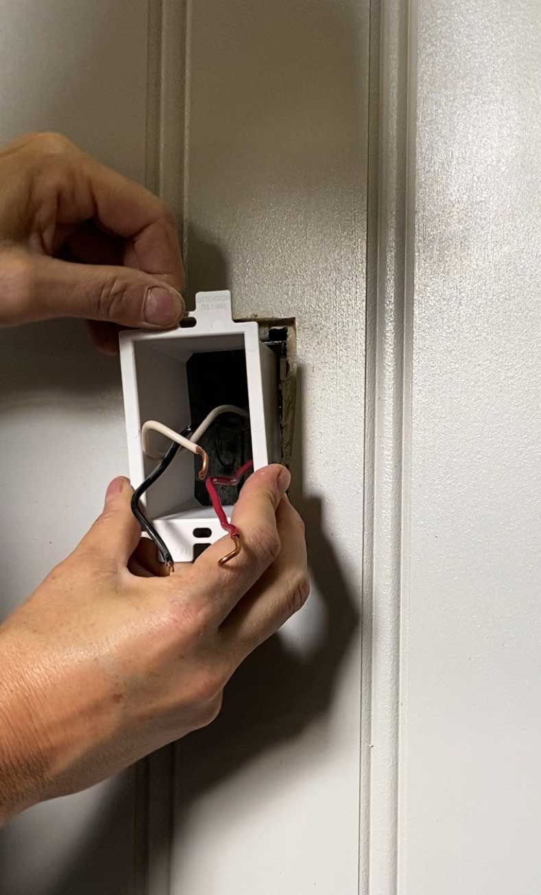 inserting outlet extender box