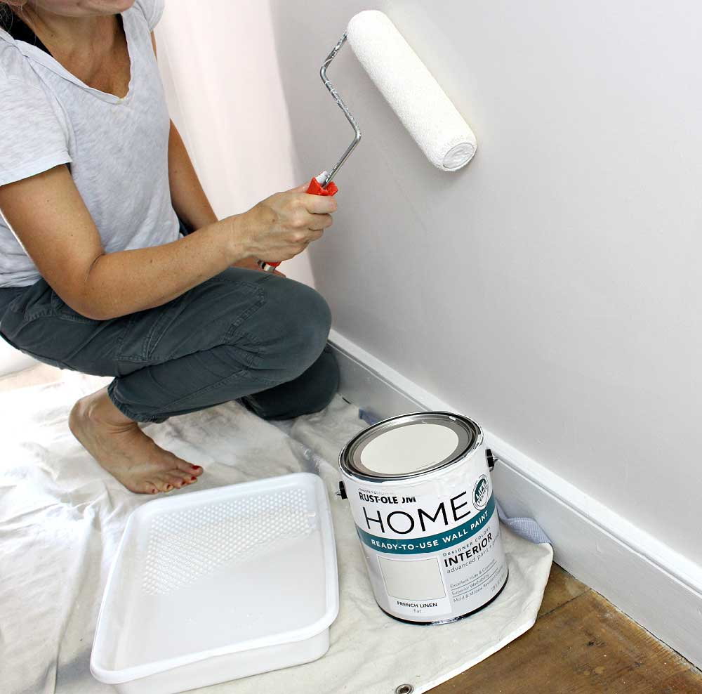 rolling paint on walls