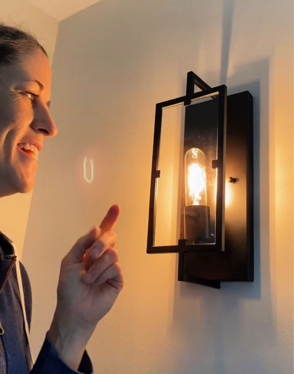 Edison light bulb in wall sconce