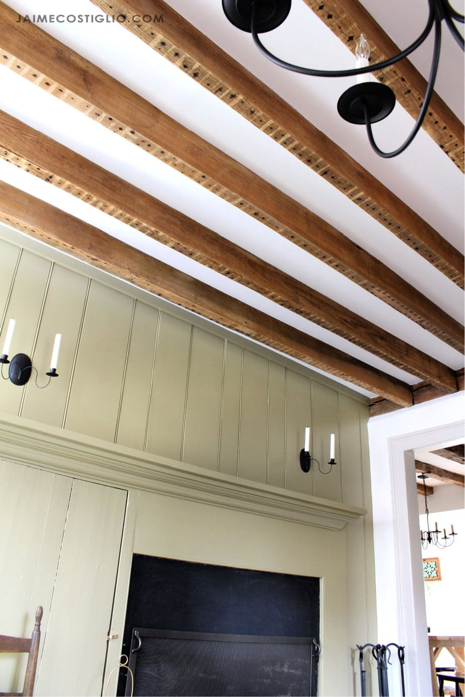 exposed wood beams with beadboard wall