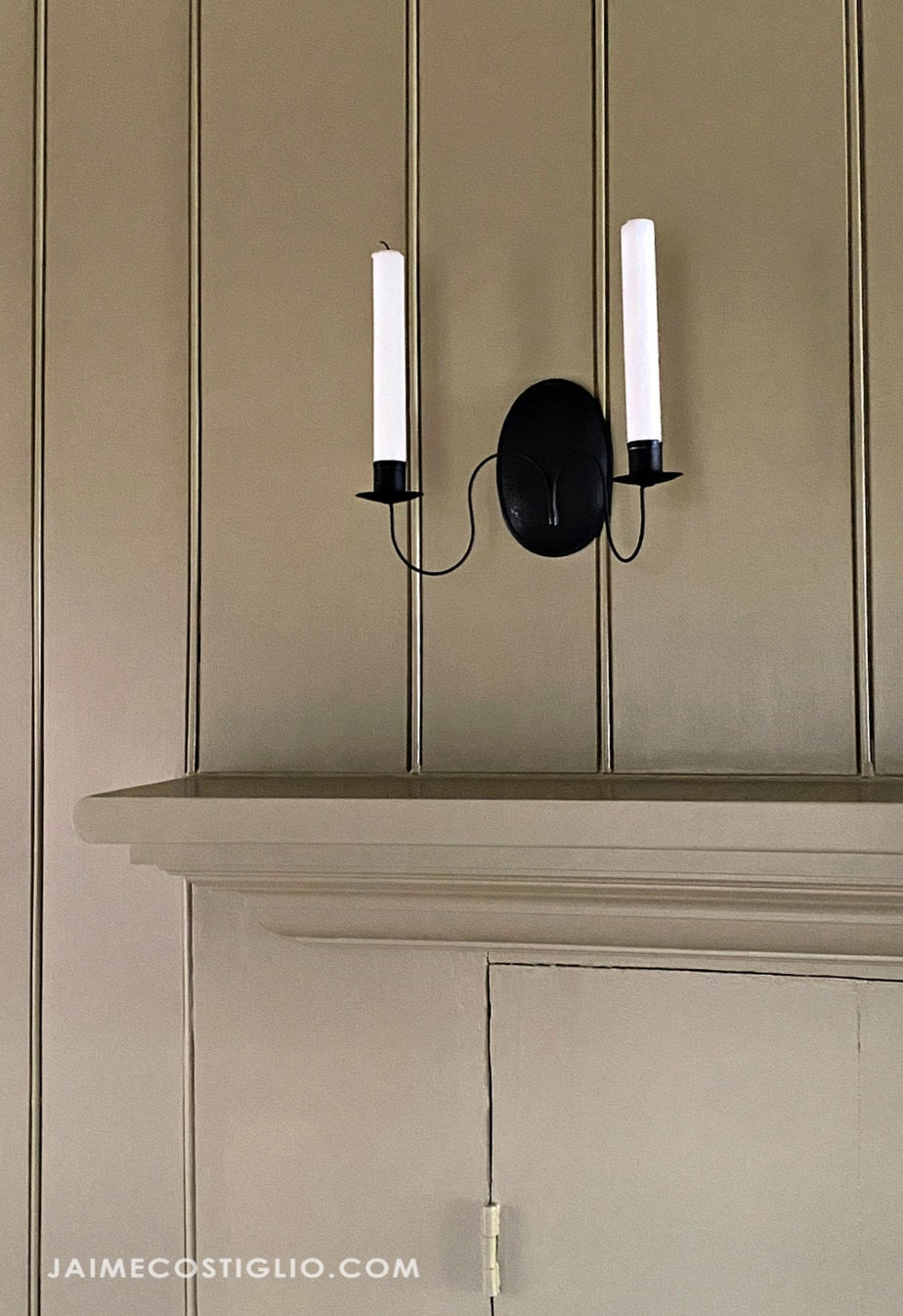 black wall sconce over mantel
