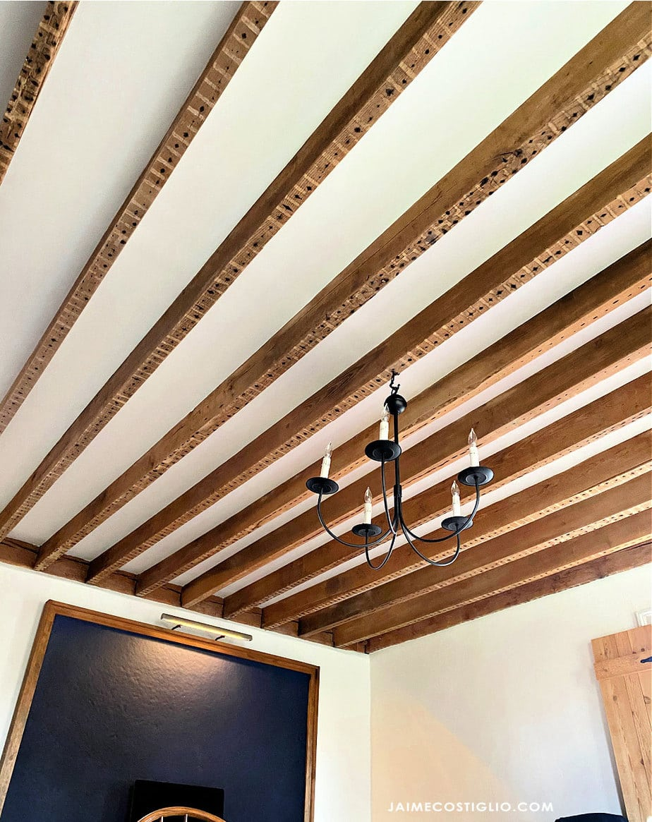 exposed wood beams with sheetrock