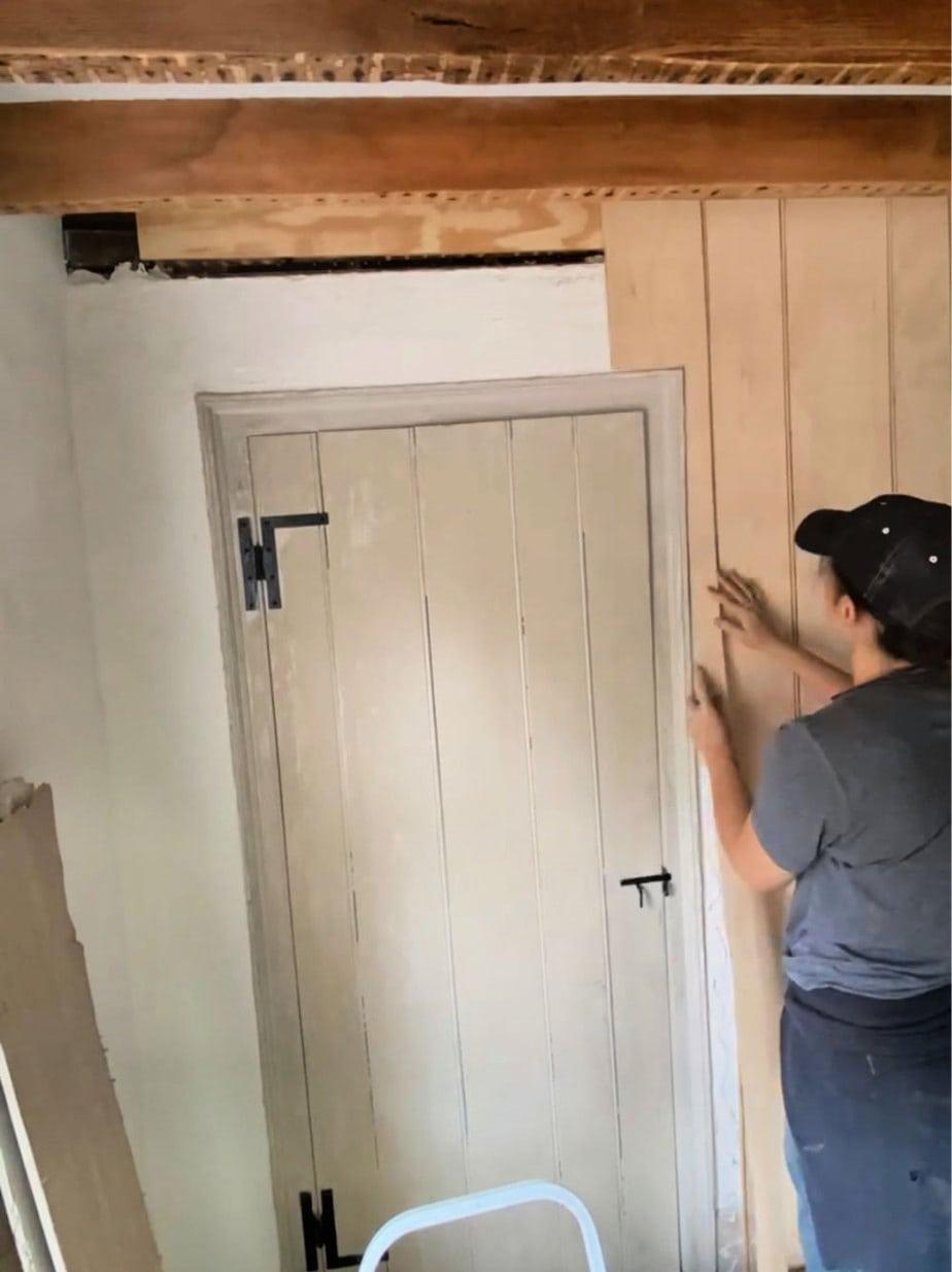 cutting panel around door moulding