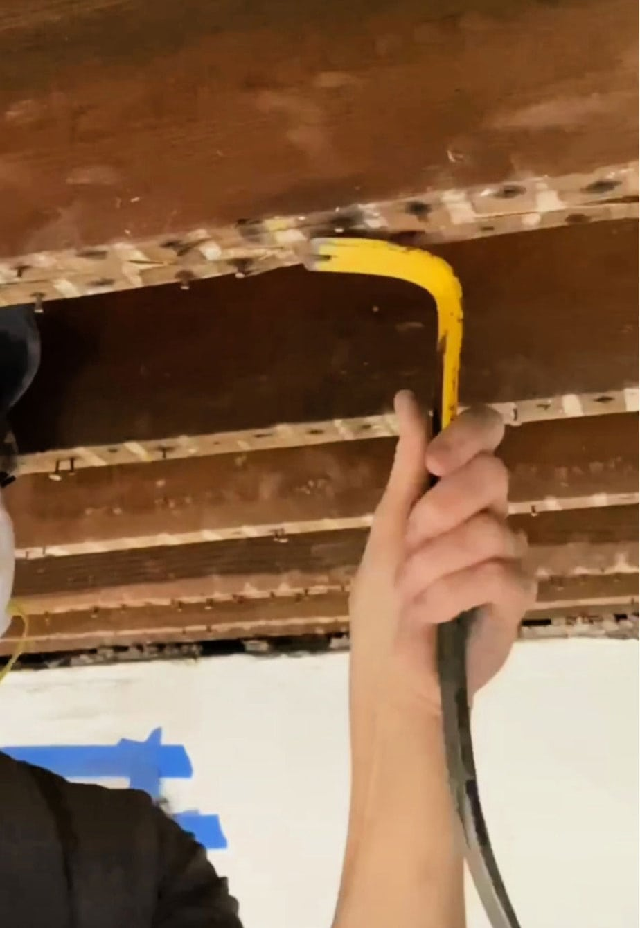removing nails from exposed beams