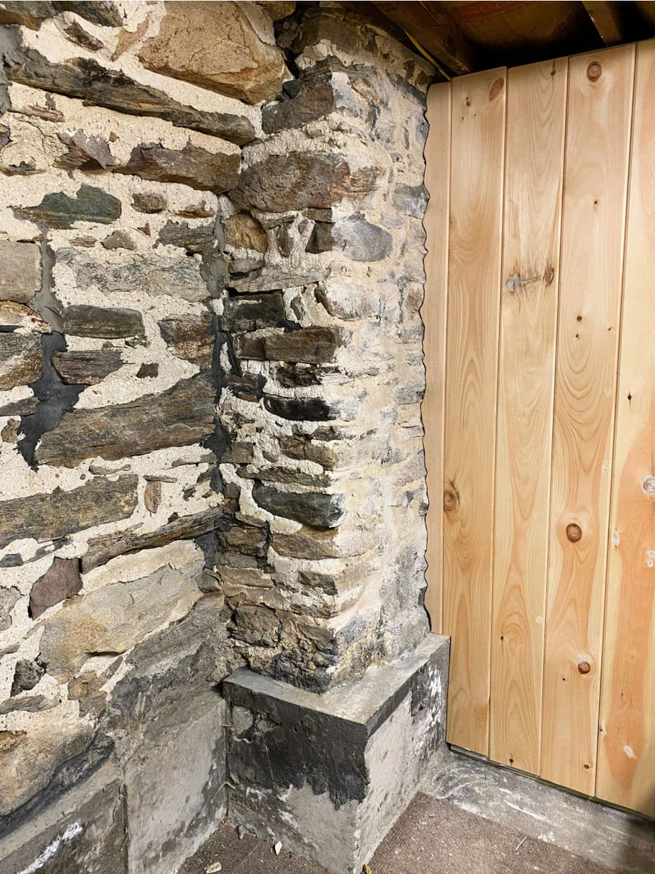 shiplap scribed to stone wall