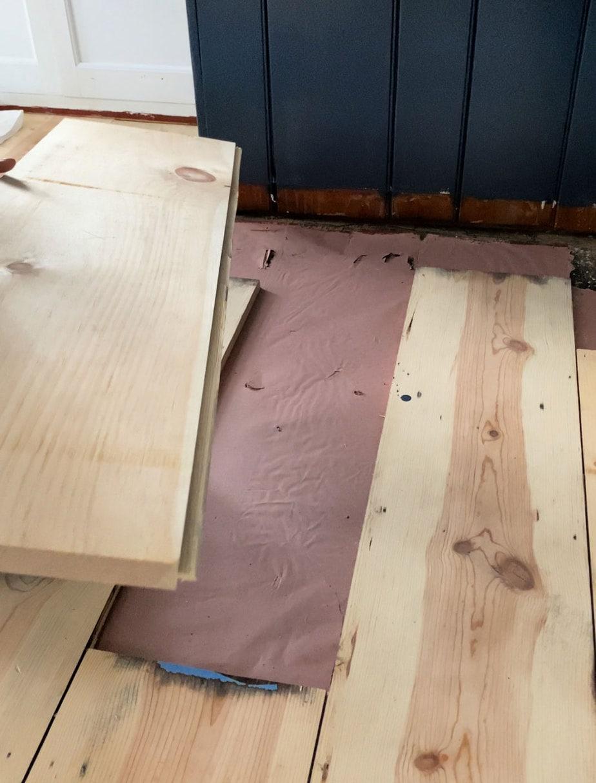 installing replacement floor boards