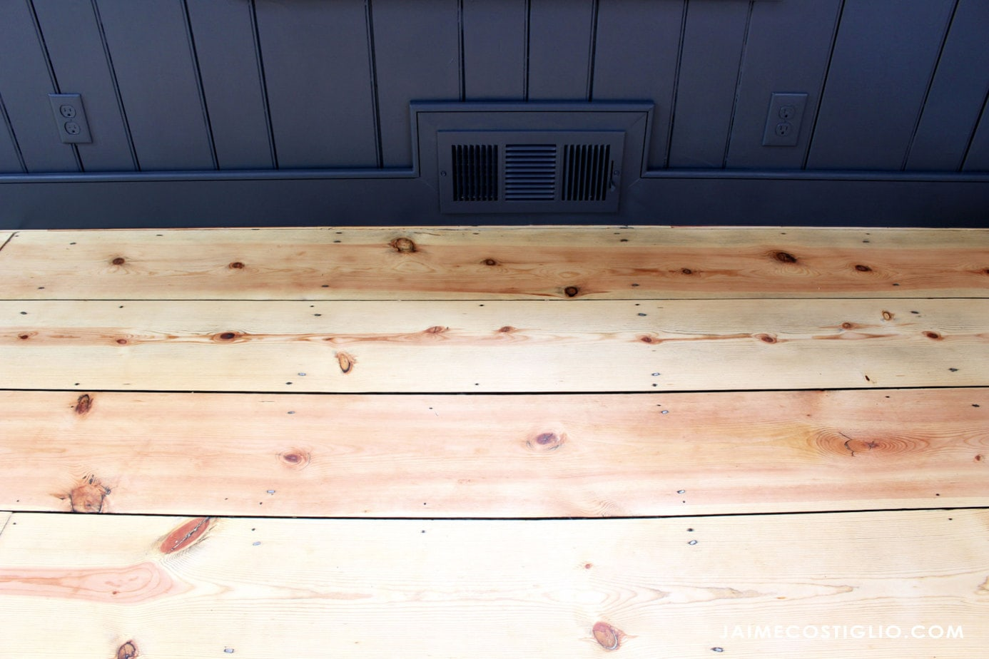 pine flooring with baseboards