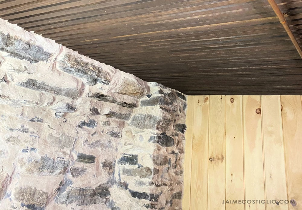 slat ceiling stone foundation wall