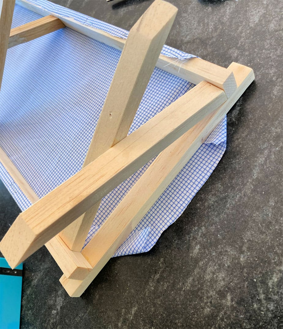 fabric ends of doll cot