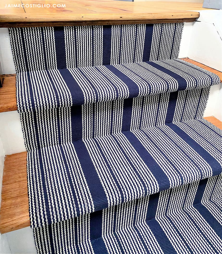 striped runner with exposed wood