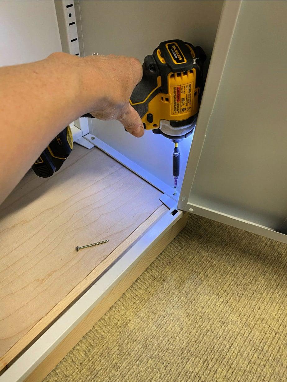 attach locker to base frame